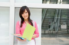 asian chinese college female student with campus background - stock photo