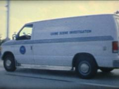SUPER8 USA crime scene investigation official bus on the highway Stock Footage