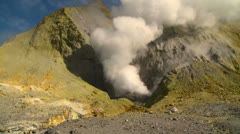 Steam rises from volcanic vents in a crater on the small New Zealand Island of Stock Footage