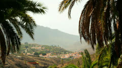 Dolly shot of Village in Moutains of Grand Canaria view thru Palms, Spain Stock Footage