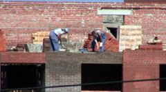 Works at the construction site. Bricklaying Stock Footage