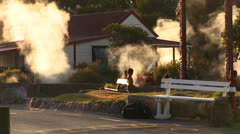 Smoke rosies from around homes and buildings in the geothermal area of Rotorua, Stock Footage