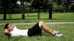 Male exercising abs. sit-ups workout. side view Stock Footage