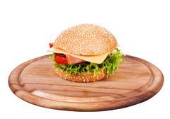 Hamburgers on wooden board isolated - stock photo