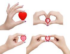 Heart symbol in hands Stock Photos