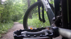 Bicycle ride through forest. Wheel angle Stock Footage