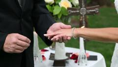 Her ring being placed on finger Close up Stock Footage