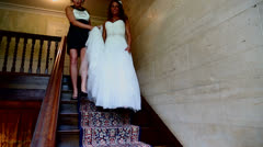 Bride desends stairs Stock Footage