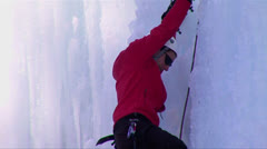Close up of a man climbing a frozen waterfall. Stock Footage