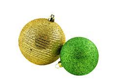 Christmas balls over shiny red and yellow  tinsel Stock Photos