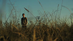Man Standing in Field, Color Corrected - stock footage