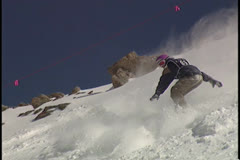 Snowboard Crashes off cliff into powder Stock Footage