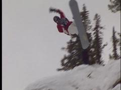 Snowboarder crashes off a jump Stock Footage
