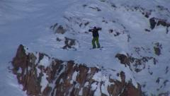 Snowboarder jumps cliff and crashes Stock Footage