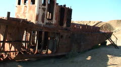 Old abandoned ships signify the ecological disaster that is the Aral Sea in Stock Footage