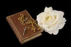 Rosary and bible Stock Photos