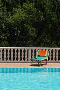 sun bed at the swimming pool - stock photo