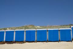 Sininen pieni uimaranta-talot Kuvituskuvat