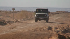 An old jeep passes on a road near the Aral Sea in Uzbekistan. Stock Footage