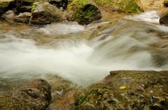 Fast flowing water Stock Photos