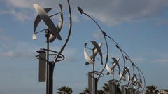 Row of vertical axis wind turbines Stock Footage