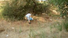 Volunteer cleaning forest Stock Footage