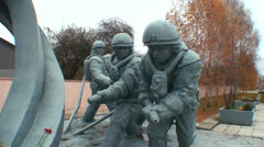 A monument honors the heros of the Chernobyl nuclear disaster. - stock footage