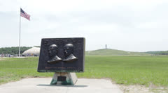 Wright Brothers memorial with field and flag in background Stock Footage