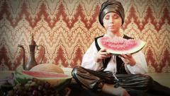 Little Padishah greedily eats ripe watermelon Stock Footage