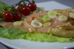 Fresh salad and smoked salmon Stock Photos