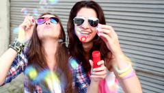 Cheerful hipster girls with sunglasses having fun making bubbles - stock footage