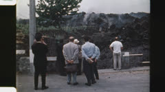 Residents watch advancing lava. (Vintage 1970's 16mm film footage). Stock Footage