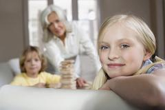 Grandmother and grandchildren (8-9) playing togehter, granddaughter in Stock Photos