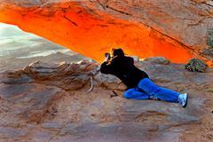Meas Arch southern Utah sunrise female photographer Stock Photos