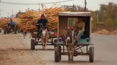 Primitive vehicles travel on a road in Uzbekistan. Stock Footage