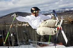 Snow ski jump crossed skis skilled recreation winter Stock Photos