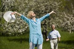 Germany, Baden Wurttemberg, Tubingen, Senior Woman bathing in Sunlight, senior Stock Photos