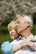 Germany, Baden Wurttemberg, Tubingen, Senior couple embracing, eyes closed, - stock photo