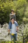 Stock Photo of Germany, Baden Wurttemberg, Tubingen, Father with son (11) on shoulders