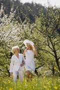 Germany, Baden Wurttemberg, Tubingen, Mature mother and adult daughter walking - stock photo