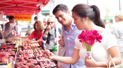 Young Couple Buying Peaches at Farmers Market Stock Footage