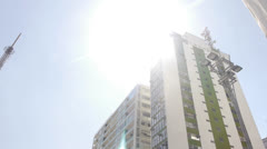 Buildings, sun and antenna - stock footage
