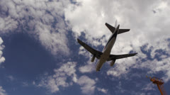 Airplane landing at city airport IV Stock Footage