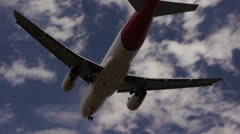 Airplane landing at city airport V Stock Footage