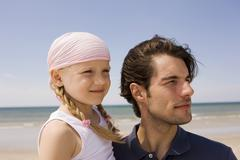 Germany, Baltic sea, Father and daughter (6), portrait, close-up - stock photo