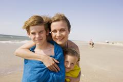 Stock Photo of Germany, Baltic sea, Mother with children, wrapped in towels, portrait