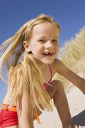 Germany, Baltic sea, Girl (6-7) in sand dunes - stock photo
