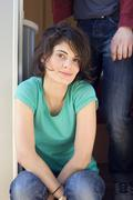 Germany, Leipzig, Ammelshainer See, Young woman in camping trailer, portrait - stock photo