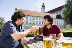 Germany, Bavaria, Upper Bavaria, Two men in beer garden Stock Photos
