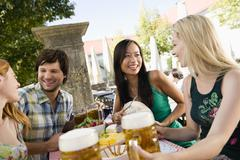 Germany, Bavaria, Upper Bavaria, Young people in beergarden - stock photo